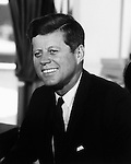 President John F. Kennedy, Jr. in the Oval Office of the White House.